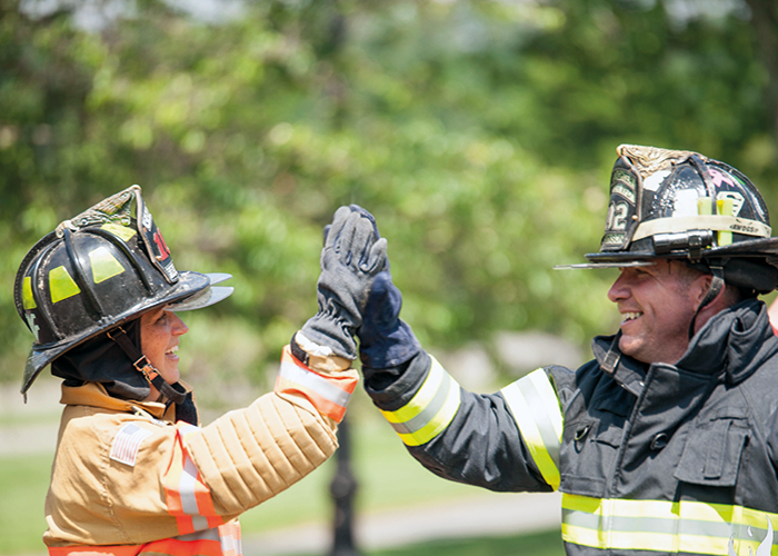 High five – firefighter Dan Mercer and his Wife Lori high five at the Commitment Weekend festivities.