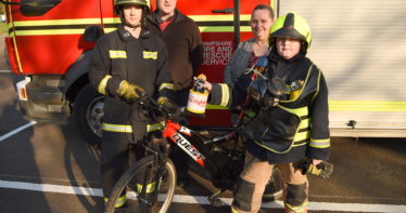 Andrew at HFRS HQ with firefighter Julie Jacobs and parents