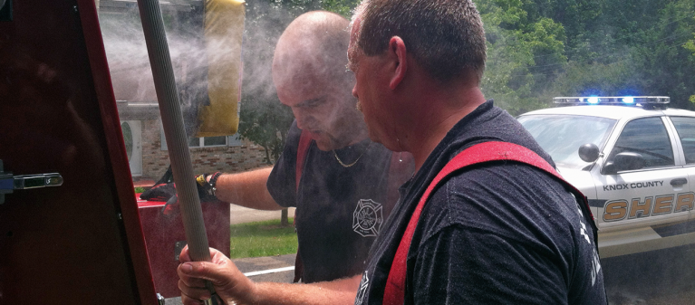 Rural Metro firefighter's Derrick Kaucher and Lt. Eric Knoefel cooling at a working structure fire in Knoxville, TN.