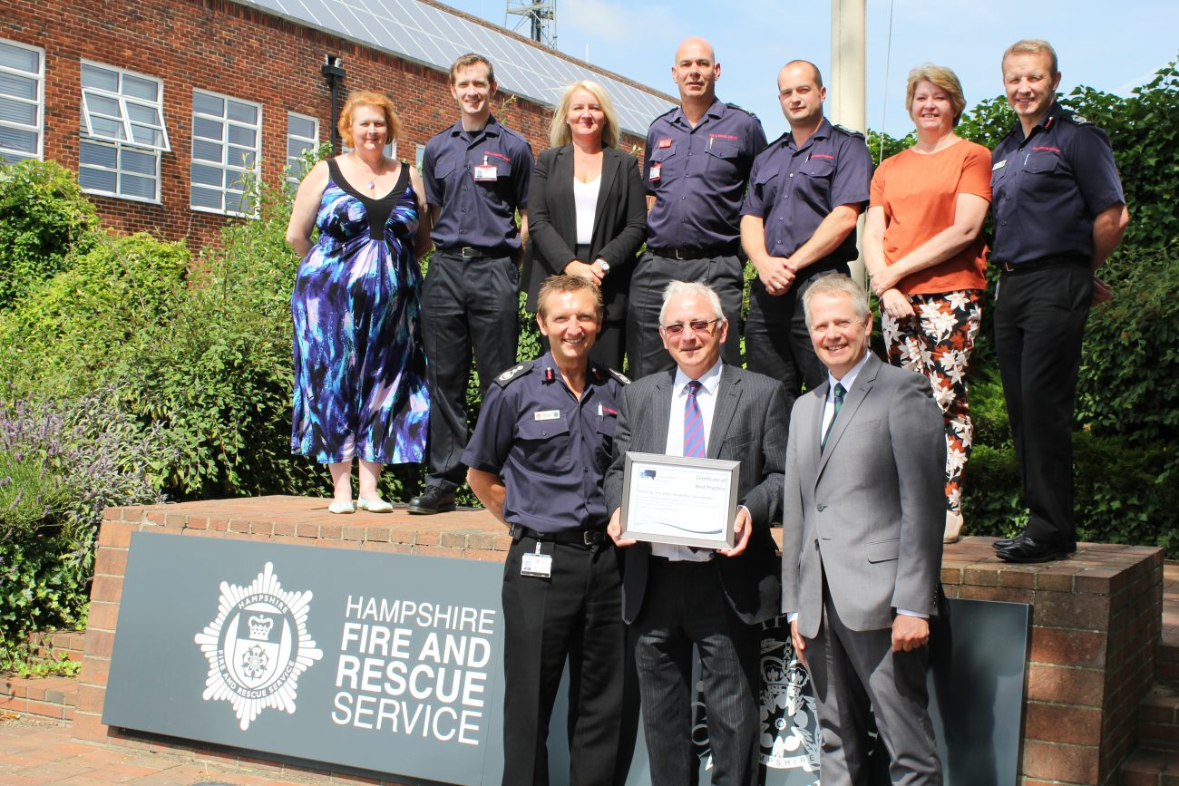 The Safer Hampshire project team - Back row: Jane Honours, Francis Long, Amanda Martin, Kevin Evenett, Ben Allen, Lee Joss, Neil Odin Front row: Chief Officer Dave Curry, Chris Carter (Chairman, Hampshire Fire and Rescue Authority), Nick Duffin (associate, Consultation Institute)