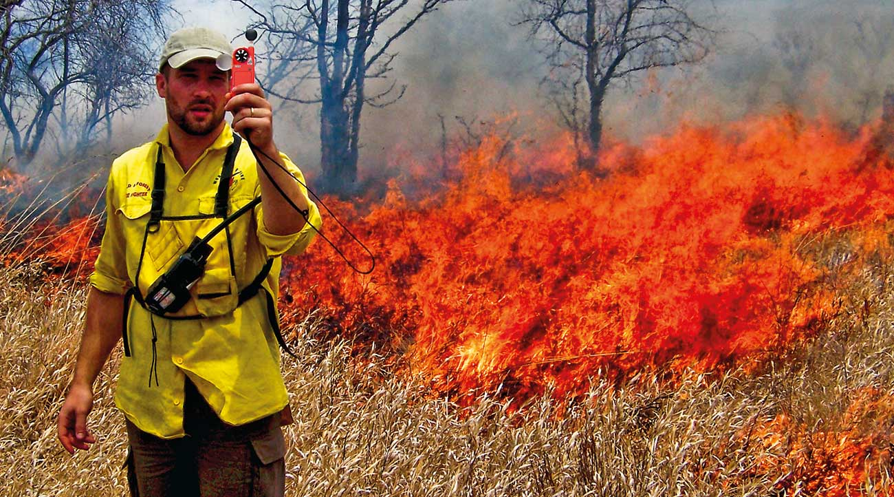 Fire authority (below) employs a Kestrel Weather Meter to accurately gauge fire behavior and adjust tactics.