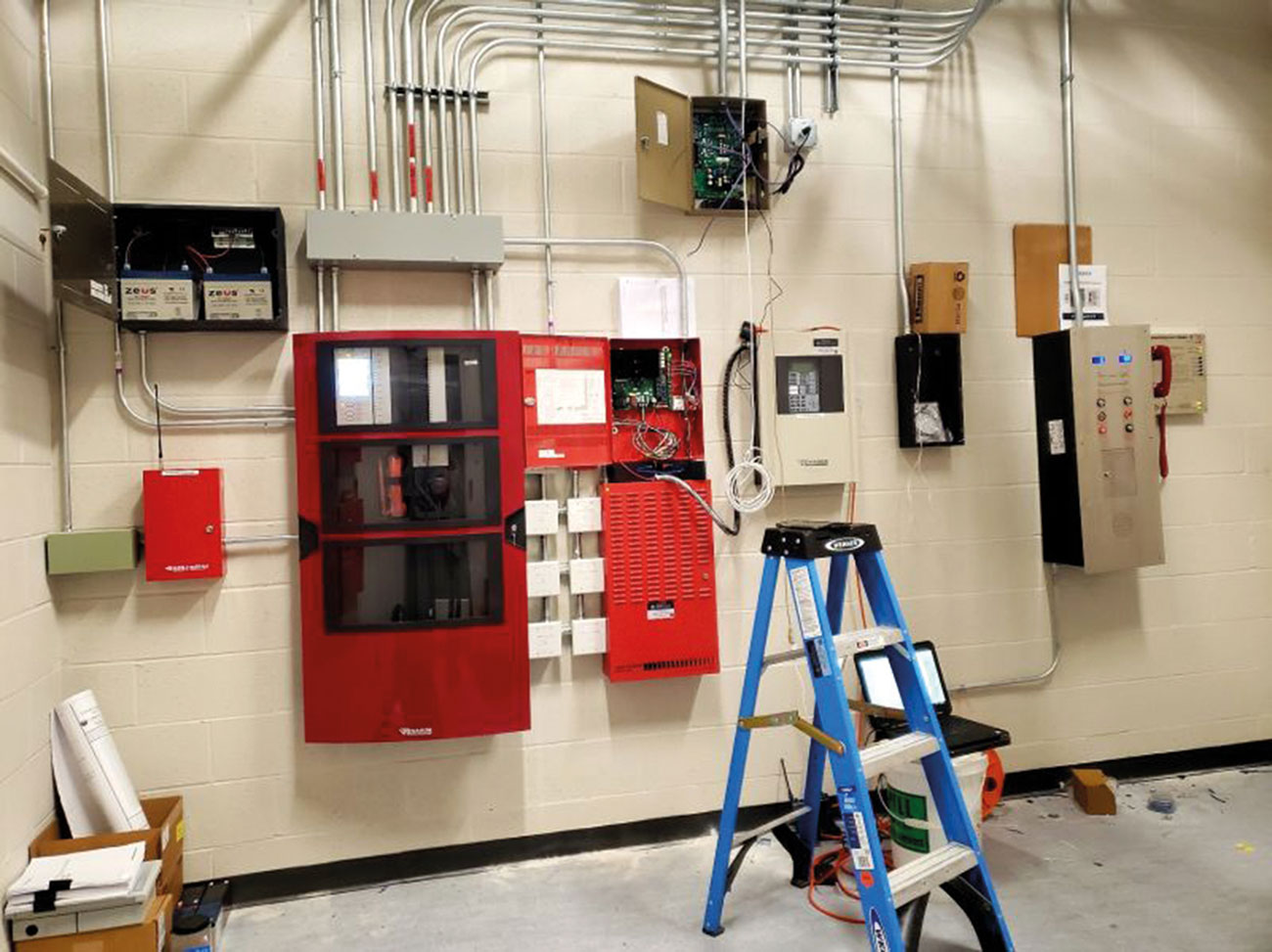 Fire alarm control room under construction that shows a fire alarm panel and integrated system controls.