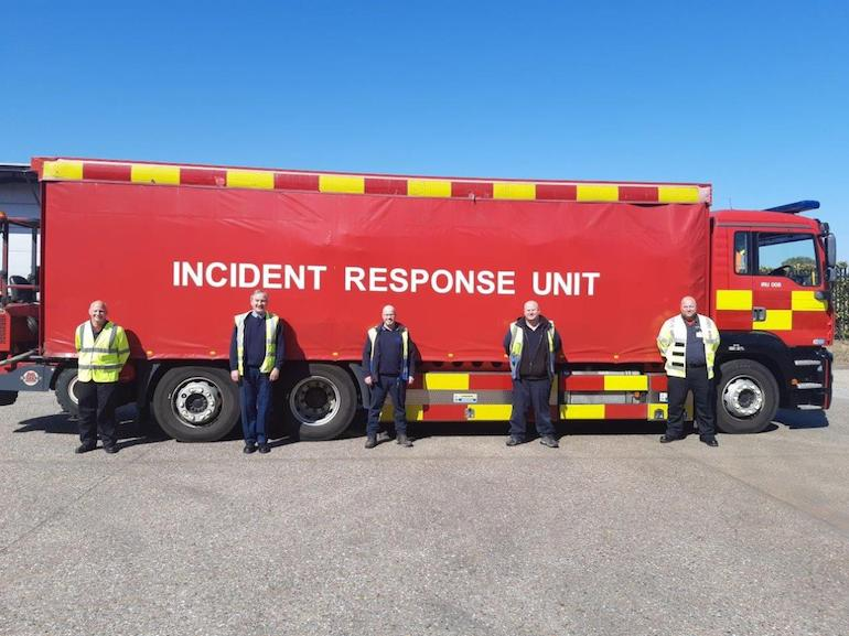 NFRS staff assisting with moving medical supplies. (NFRS)