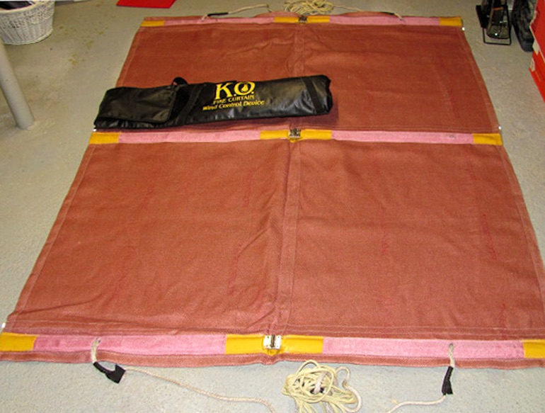 The 'F' Type fire curtain unrolled with bag. (K.O. Fire Curtain)